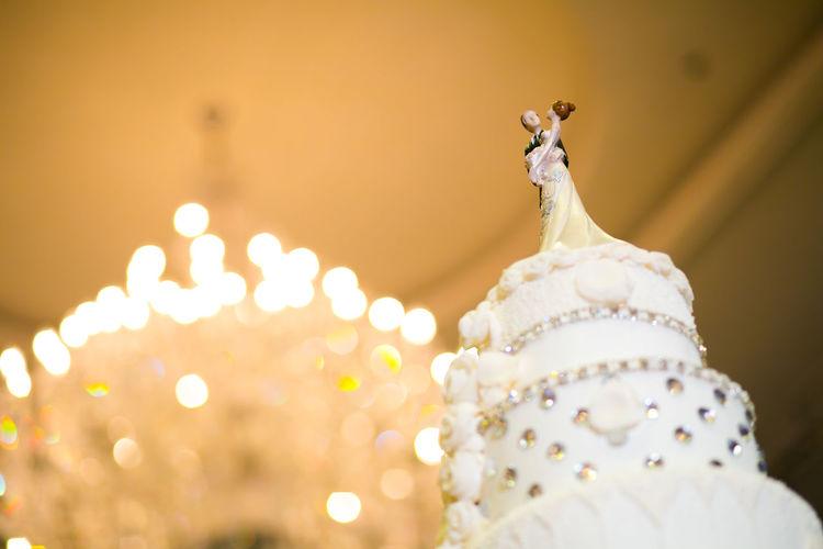 Close-up of figurine on illuminated cake