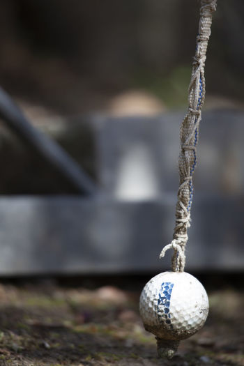 Close-up of ball hanging on rope
