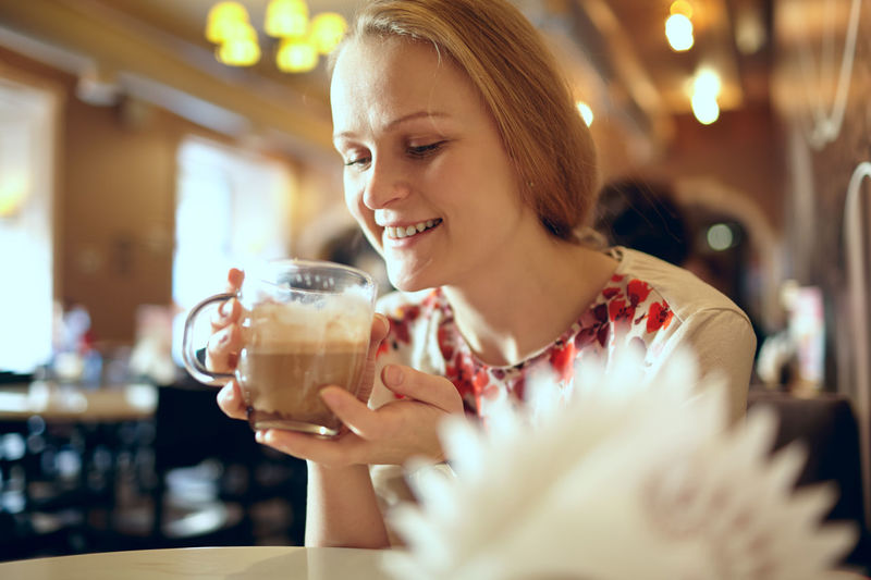 Beautiful Happy Woman Having Cappuccino In Cafe
