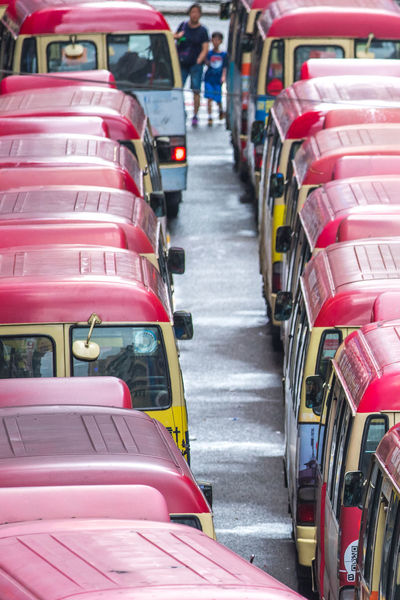 HongKong Red Road Abundance Arrangement Car City Day Empty Focus On Foreground In A Row Incidental People Land Vehicle Large Group Of Objects Minibuses Mode Of Transportation Mongkok Order Outdoors Red Repetition Seat Stack Street Transportation Wheel
