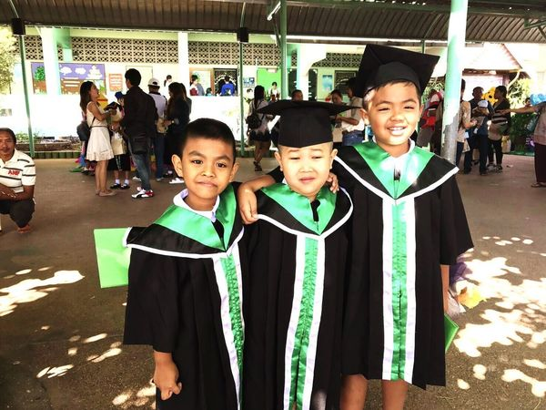 Congratulations 🎊 Looking At Camera Portrait Boys Large Group Of People Real People Standing Smiling Childhood Happiness Lifestyles Outdoors Day People EyeEm Gallery Boys Boys Boys School Life