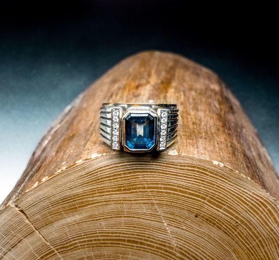 Close-up of ring on wood