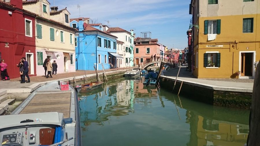 Architecture Blue Building Exterior Canal City Day Gondola - Traditional Boat Island Nautical Vessel Outdoors People Red Sky Travel Destinations Traveling Water Yellow Water Reflaction Houses And Windows House Bridge