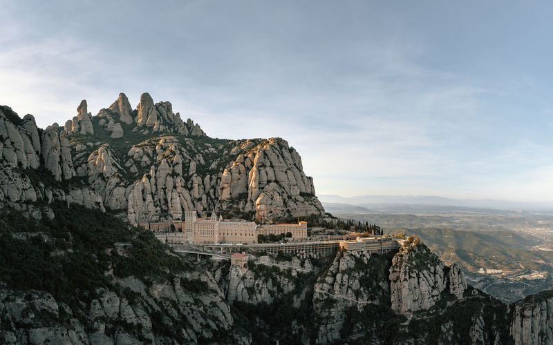 Panoramic view of historic building against rock formation