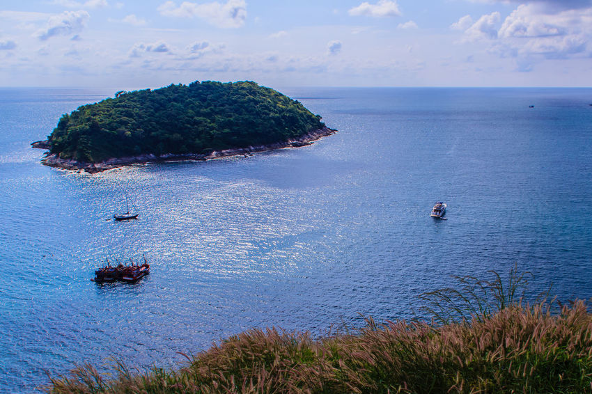 Beautiful seascape view of phuket cliff and small islands nearby Promthep cape, the most beautiful sunset viewpoint in Phuket, Thailand. Coastline Coastline Landscape Coastline Landscape Blue Beach Sea Outdoors Sky Scenics Real People Nature Day Water Coastline Nature Water Grass Sea Sky PromThepCape Promthep Cape Aerial View Beauty In Nature Cliff View Cliffs And Water Cliffside Coastline Beauty Coastline Sky Day Grass And Sky High Angle View Horizon Over Water Nature No People Outdoors Promthep Scenics Sea Sky Small Island Small Islands Tranquil Scene Tranquility Viewpoint Water