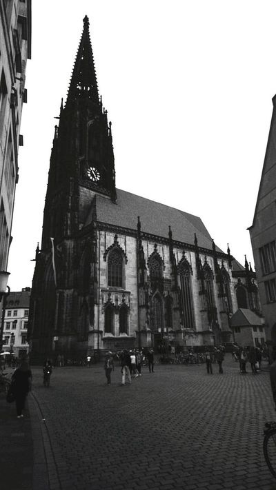 Architecture Built Structure History Religion Travel Destinations Building Exterior Museum Cloud - Sky Place Of Worship Spirituality Large Group Of People City Clock Day People Politics And Government Outdoors Sky Clock Face Adult The Street Photographer - 2017 EyeEm Awards The Architect - 2017 EyeEm Awards Münster Lambertikirche Mobility In Mega Cities