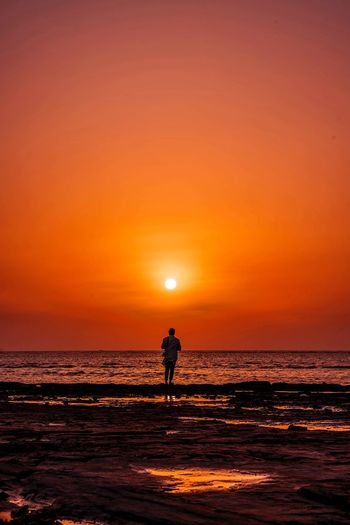 Walking into the sunset Sky Sea Sunset Orange Color Water Scenics - Nature Beauty In Nature Real People Silhouette Horizon Over Water Land One Person Lifestyles Horizon Beach Leisure Activity Men Sun Nature Outdoors
