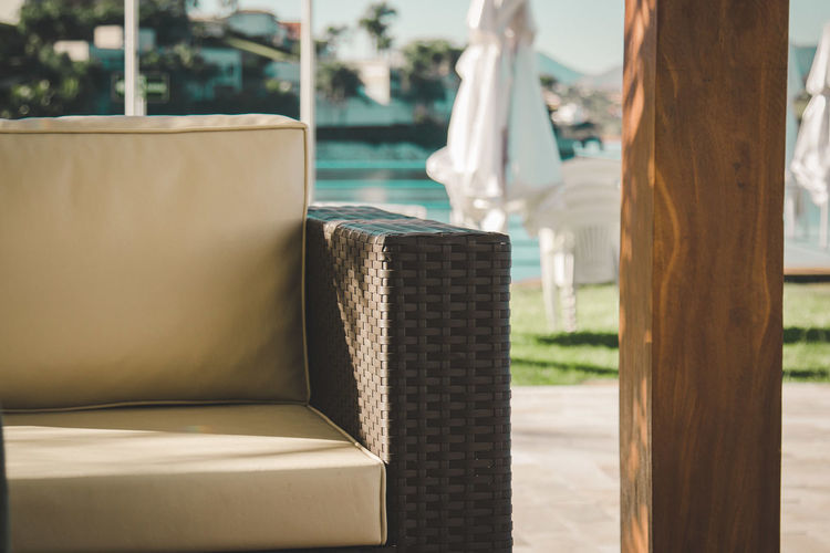 Sofa By Wooden Column At Yard