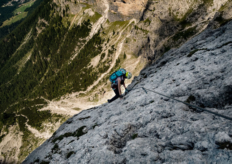 High Angle View Of Person Climbing On Rock