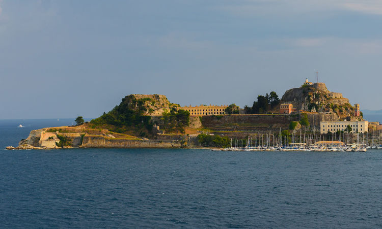 CORFU ISLAND Holiday Old Fortress Architecture Beauty In Nature Building Exterior Built Structure Corfu Corfu City Day Go-west-photography.com Greece History Ionian Islands Ionian Sea Nature No People Outdoors Rock - Object Sea Sky Summer Travel Destinations Water Waterfront