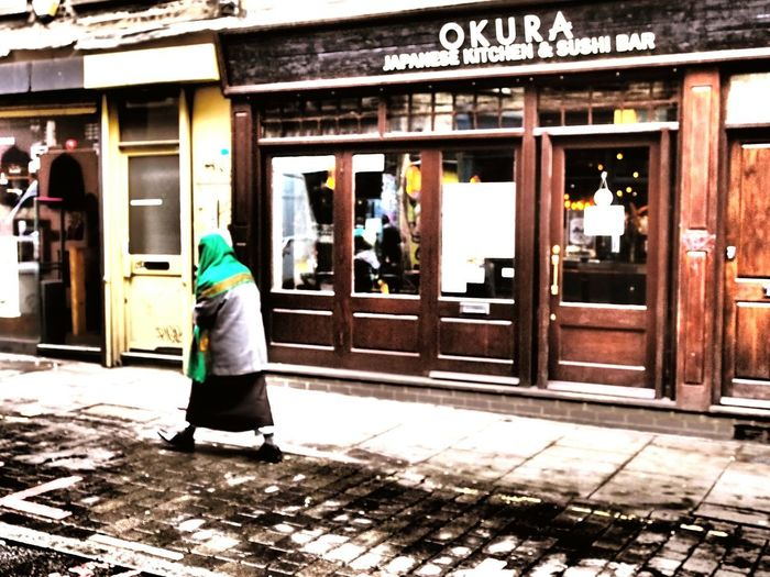 Street Photography Colour Of Life Colorful Shawl Woman Walking On The Street Woman Walking Old Woman Shop Window Brick Lane Outdoors London Building Exterior