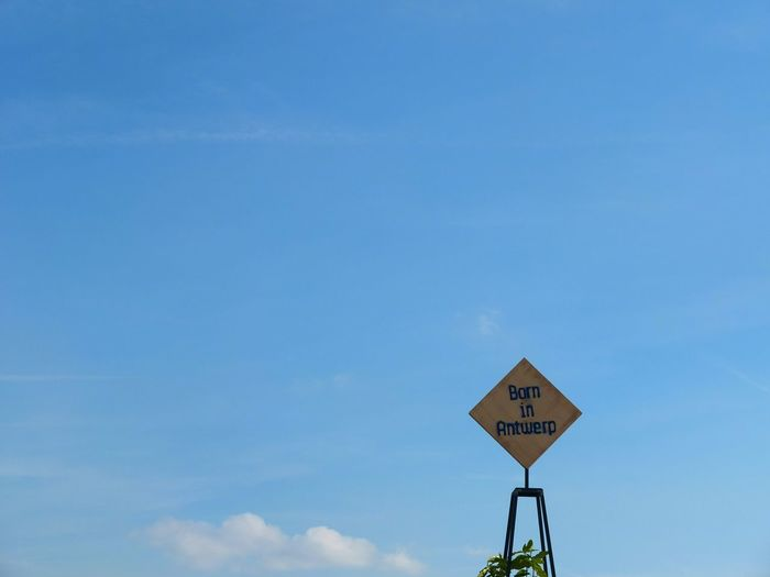 Road Sign Against Sky