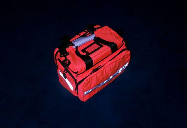Close-Up Of Red Bag Over Black Background
