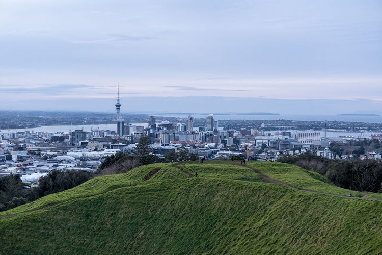 Auckland Mt Eden Mt Eden Auckland New Zealand Skyline Architecture Building Building Exterior Built Structure City Cityscape Cloud - Sky Day Environment Grass Green Color High Angle View Landscape Nature New Zealand No People Office Building Exterior Outdoors Plant Sky Skyscraper Tall - High Travel Destinations