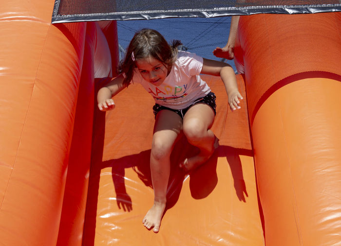 Girl in obstacle course Obstacle Course Child Childhood Girl Innocence Leisure Activity Orange Color Outdoors