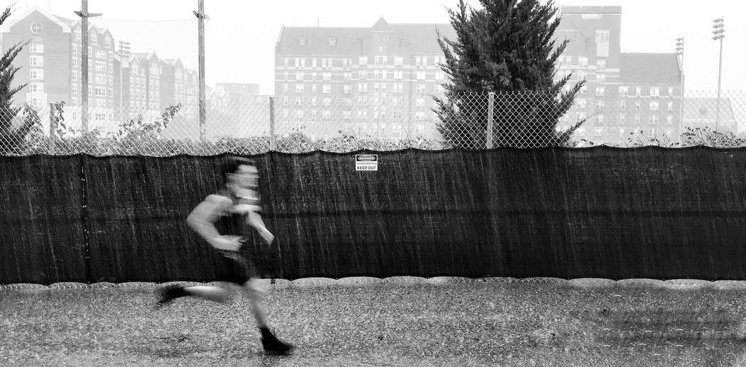 Running Man! #georgetown #university #raining #ardavanart Blackandwhite Ardavanart University Road Rain Running