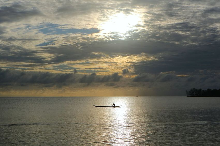 The rhythm of the waves of the sea of siberut ... Manaikoat cottage is where we dove and be happy in the morning and grateful to feel the amazement of the handmade of the Lord of our nation Indonesia, where we can enjoy the beautiful sunrise on the east of the island, the sea view of siberut island, is the charm The beautiful islands mentawai which is a group of western islands of western sumatera province, its beauty is very dangerous, when standing and see the angle of sea view hence this attention very charming beautiful. Photos and text by James a Watulingas. Beauty In Nature Boat Canon Canon Eos  Canon M3 Canonphotography Cloud - Sky Fishing Fishing Boat Horizon Over Water Nature Outdoors Reflection Scenics Sea Seascape Silhouette Sky Sky And Clouds Sunrise Sunset TranquilityWater EyeEmNewHere The Great Outdoors – 2017 EyeEm Awards