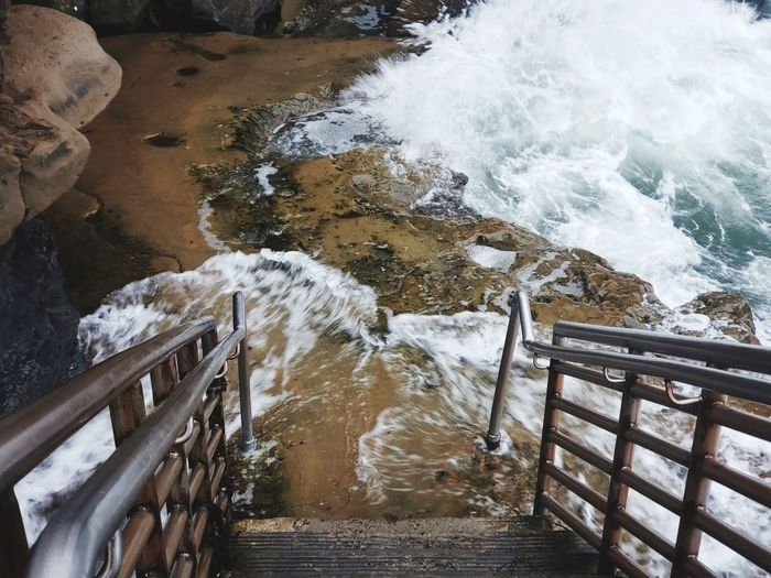 High angle view of water flowing through railing