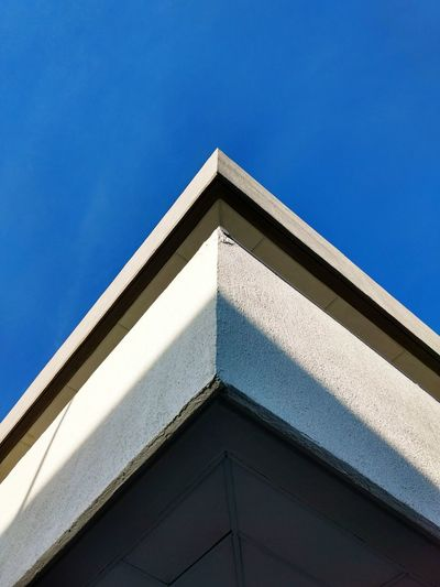 Architecture Architecture Low Angle View Built Structure Building Exterior Clear Sky Blue Day Geometric Shape Outdoors Pediment Angle Repetition Façade Architectural Feature High Section No People TakeoverContrast