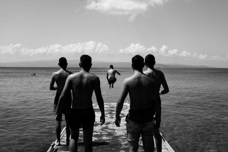 Rear view of men on beach
