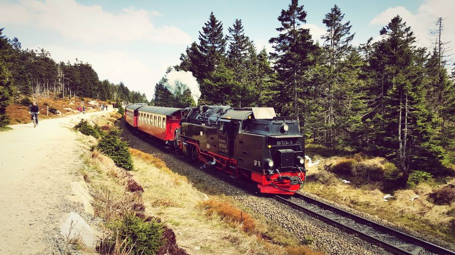 Steam train moving by road