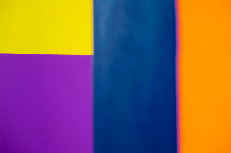 Abstract geometric pattern on concrete wall Art And Craft Backgrounds Blue Choice Close-up Copy Space Creativity Flag Full Frame Indoors  Multi Colored No People Pattern Pink Color Purple Studio Shot Textured  Variation Vibrant Color Wall - Building Feature Yellow