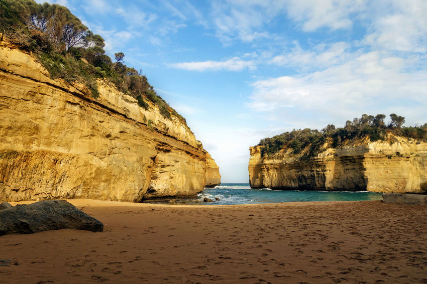 Limestone Stacks. Port Campbell. Australia Beach Beauty In Nature Cliff Cloud - Sky Day Eroded Land Nature No People Outdoors Rock Rock - Object Rock Formation Sand Scenics - Nature Sea Sky Solid Stack Rock Tranquil Scene Tranquility Water