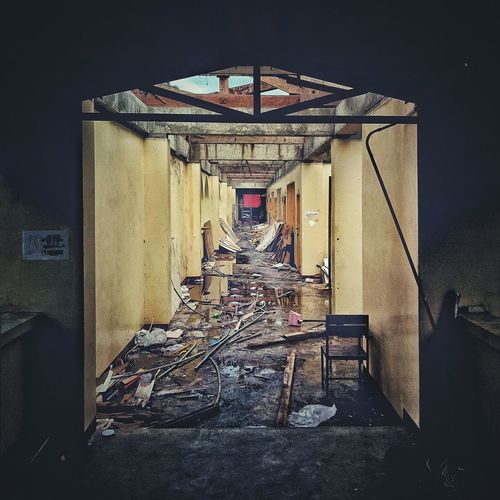 Typhoon devastated building. My Alma Mater in tertiary now a haunted tenement. It is where I started to dream big, because of the mishap, now, I dream big for it. Eyeem Philippines Eyem Photography EyeEm Best Shots EyeEm Gallery EyeEm Tenement Houses Building Construction Typhoon Mangkhut Typhoon Tropical Country Alma Mater Dreams Architecture Entryway Entrance Historic