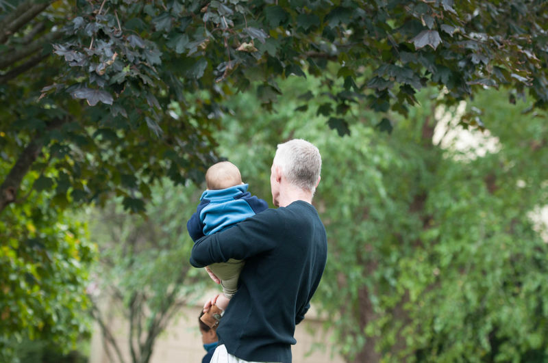 Father Holding His Son Carrying Man Bonding Child Embracing Father Holding Leisure Activity Lifestyles Love Nature Outdoors People Real People Rear View Son Togetherness Two People