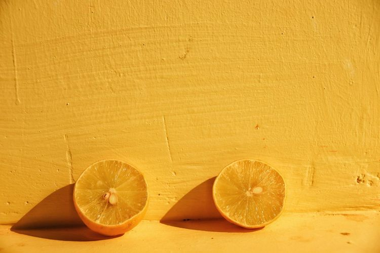 Close-up of oranges on table