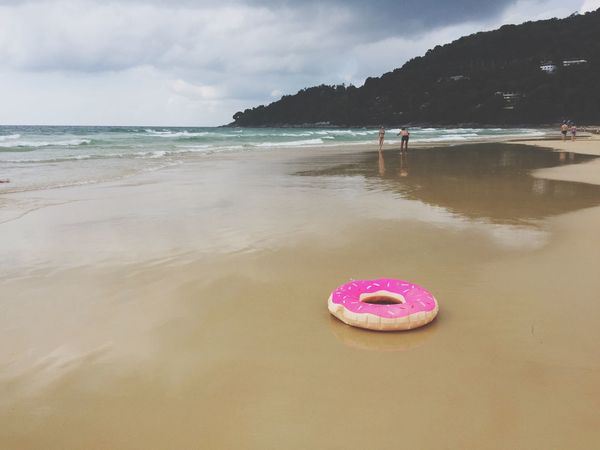 Sea Beach Water Nature Beauty In Nature Sand Outdoors Scenics Tranquility Day Horizon Over Water Shore Abondoned Rubber Ring Pink Color