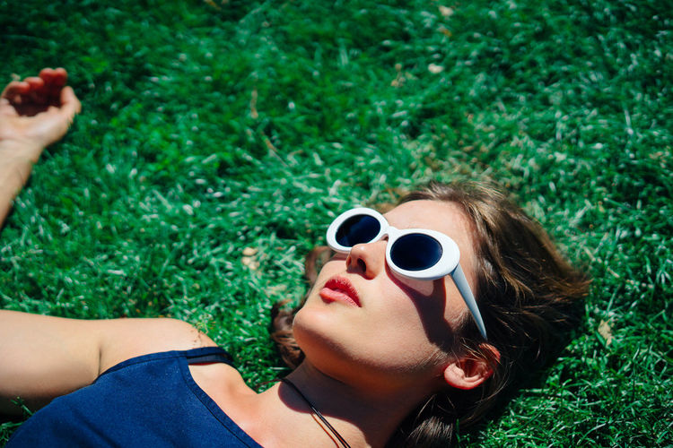 Adult Beautiful Woman Close-up Day Grass Green Color Nature One Person Outdoors People Place Of Heart Plant Real People Sunglasses Women Young Women The Portraitist - 2017 EyeEm Awards