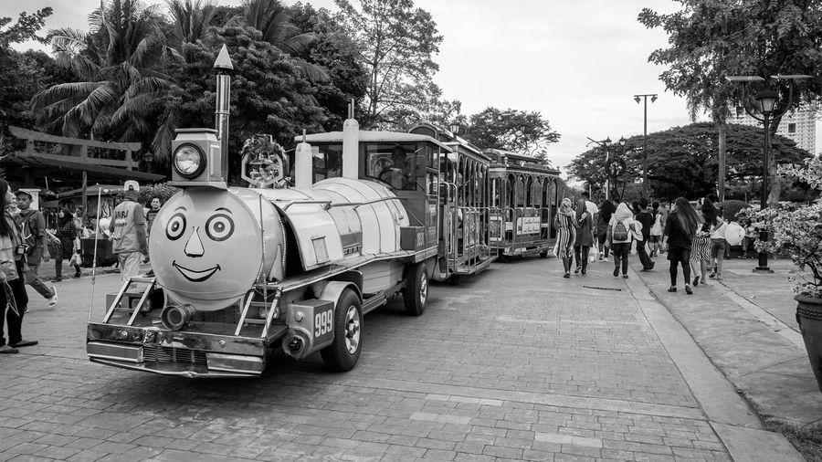 Train in Luneta Park LRT Luneta Park Manila ManilaStreetPhotography Philippines Amusement Park Bagumbayan Black And White Black And White Photography Crowd Large Group Of People Mrt Old Train Outdoors Park People Riding A Train Rizal Park Train Train In A Park Trains Transportation Tree EyeEm Ready   EyeEmNewHere