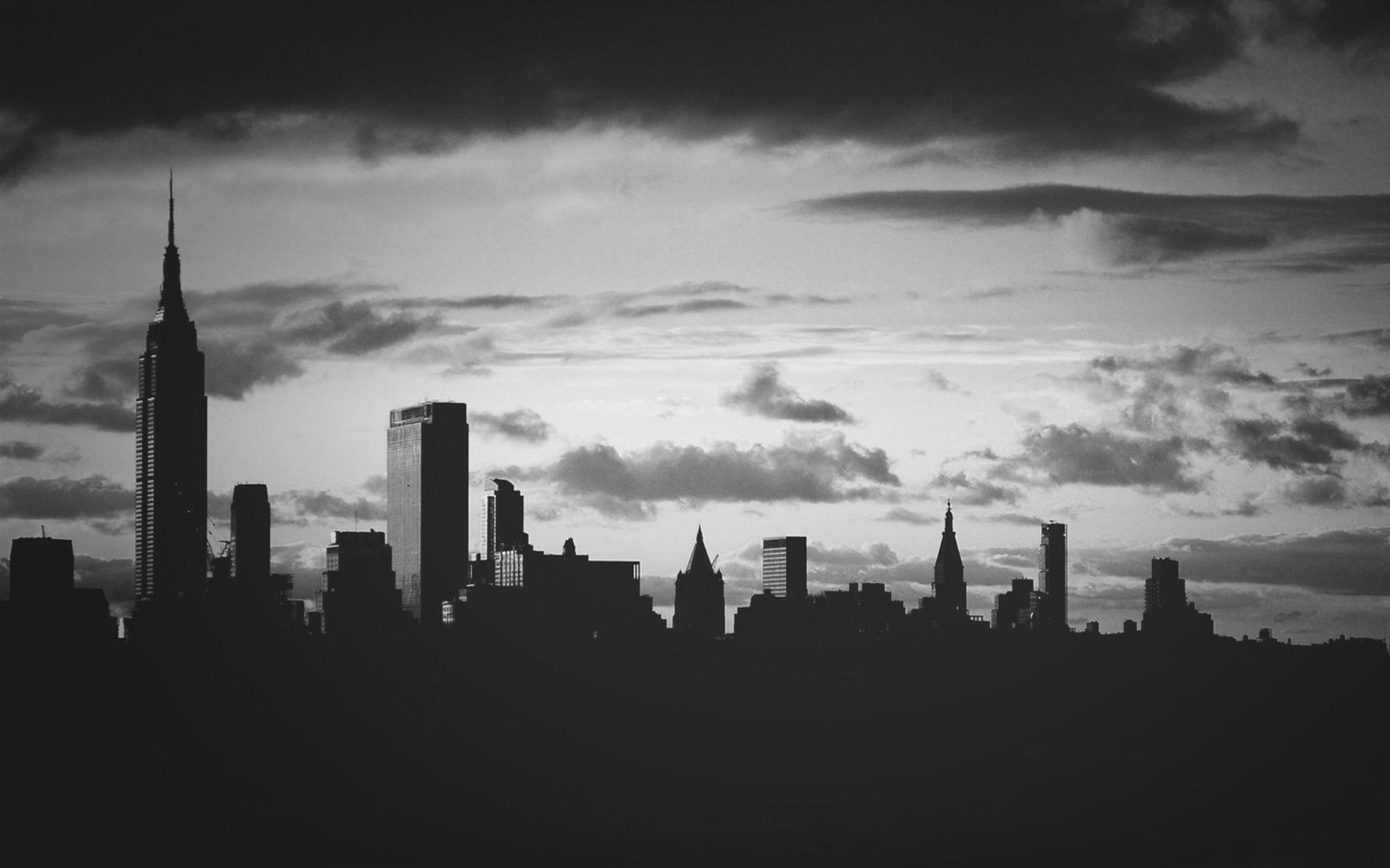 building exterior, architecture, built structure, sky, silhouette, city, skyscraper, cloud - sky, tall - high, tower, cityscape, urban skyline, cloudy, modern, office building, cloud, travel destinations, dusk, outdoors, skyline