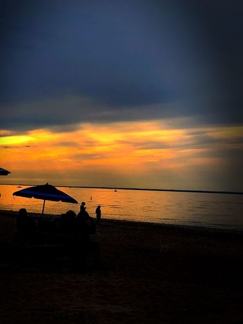The North shore at sunset, Cedar Beach. New York LongIslandNY Longisland Umbrella Silouette & Sky Silouette Sea Water Sunset Sky Beach Beauty In Nature Land