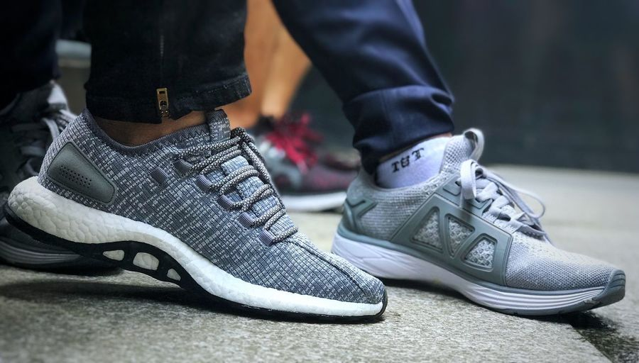 Adidas pureboost vs hunter X Viet Nam Hunter X Hunter PureBoost Adidas Shoe Real People Low Section Shoelace Close-up Men Fashion Focus On Foreground Human Body Part Day Ice Skate Togetherness Indoors