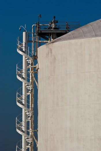 Spiral staircase on giant storage tank at petrochemical plant
