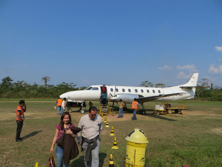 Bolivia Landing Transportation Traveling Adult Airplane Airport Airport Runway Airport Waiting Clear Sky Field Full Length Grass Jungle Men Nature Outdoors People Real People Sky Standing Togetherness Tourism Travel Destinations Women Lost In The Landscape Been There. Done That. Connected By Travel