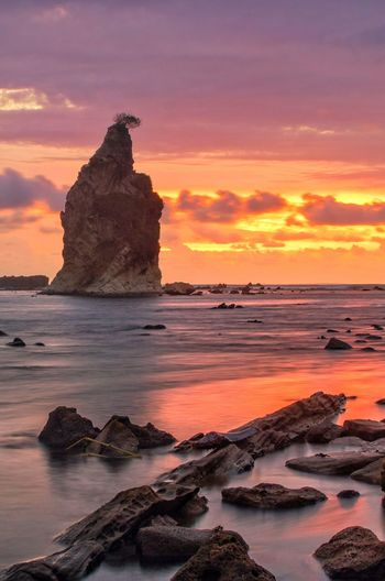 Beauty sunset Sunset Rock - Object Sea Beach Rock Formation Landscape Horizon Over Water Water Beauty In Nature Travel Destinations Tranquility No People Nature Outdoors Scenics Sky Red Cliff Wave Vacations