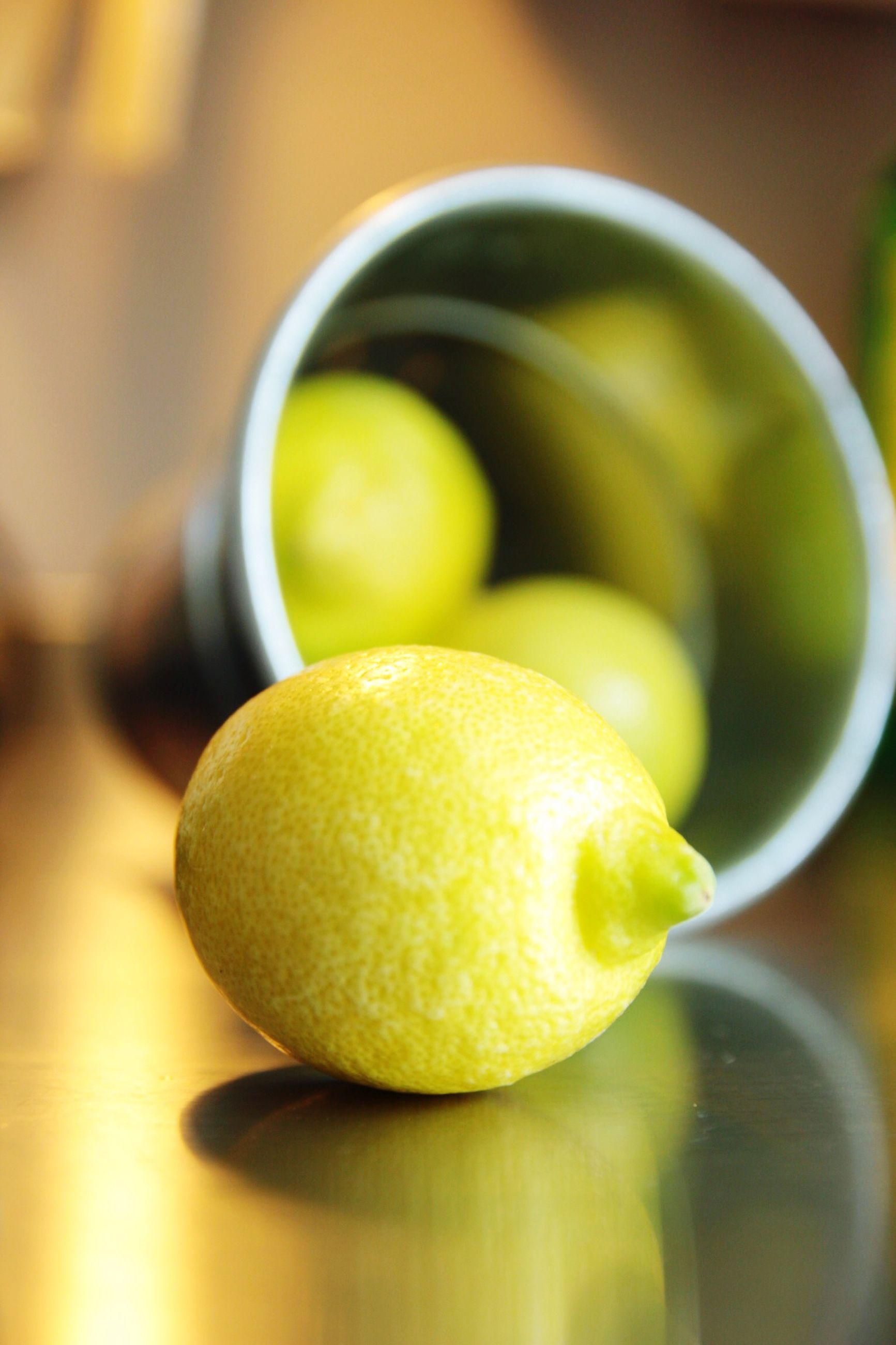 food and drink, fruit, food, freshness, healthy eating, yellow, close-up, still life, orange - fruit, indoors, focus on foreground, citrus fruit, lemon, selective focus, organic, no people, juicy, ripe, table, green color