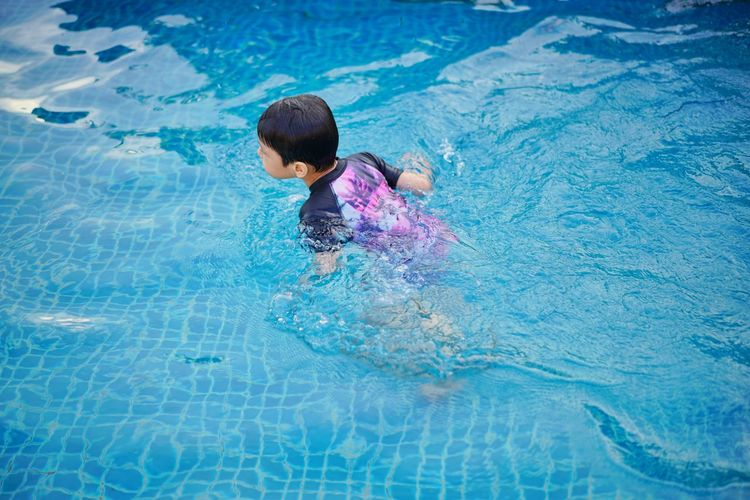 EyeEmNewHere EyeEm Kids Water Child Swimming Pool Swimming Childhood Boys Refraction Children Human Back Wearing Back Head And Shoulders Caucasian Asian  Preschooler