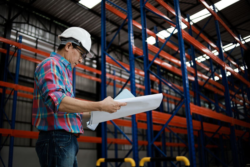 Man working while standing in warehouse