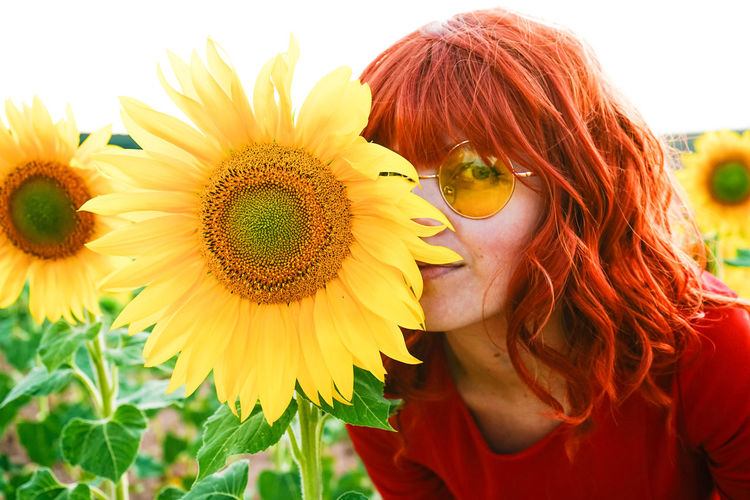 Portrait of woman with sunflower