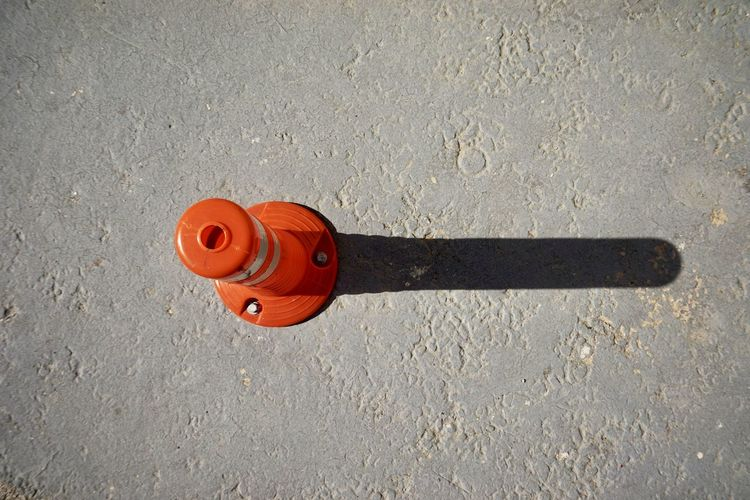 High angle view of fire hydrant against wall