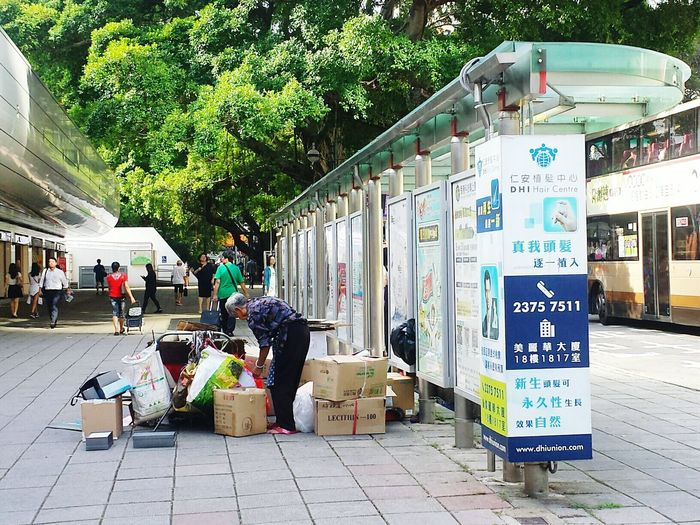 People Hello World Lady Paperboxes She HongKong City Life Bus Stop Busy Bus This is among them of social issue of one. Elderly Population. They should be obtained more treatment, more show concern, and more guarantee , more guarantee in the world.