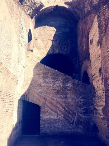 Secret nook at the Coliseum 🙌🇮🇹 Italy Architecture Built Structure Arch Shadow Day History Rock - Object Sunlight Travel Destinations Old Ruin No People Indoors  Low Angle View Ancient Civilization EyeEm Gallery EyeEm Vacations Alley Neighborhood Map Brick Wall Textured  Textures And Surfaces Secret Places Rome The Street Photographer - 2017 EyeEm Awards The Architect - 2017 EyeEm Awards Visual Feast BYOPaper! Live For The Story The Architect - 2017 EyeEm Awards The Great Outdoors - 2017 EyeEm Awards The Street Photographer - 2017 EyeEm Awards BYOPaper! Live For The Story