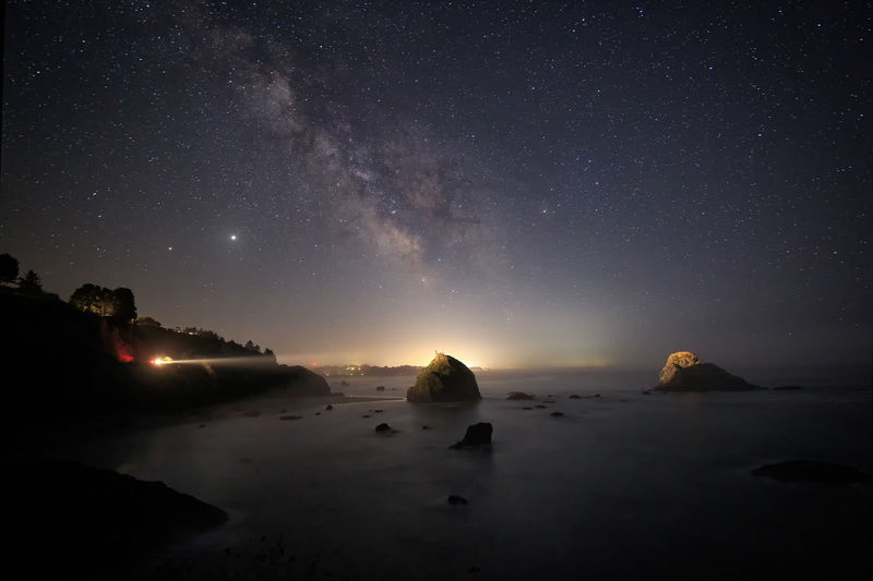 Scenic view of rocks against sky at night