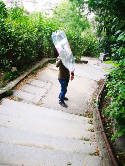 Flying bottle Bottle Flying Bottle Moments Trip Plastic Moments Of Life Sunny Day On Stairs Stairs Green One Person Day Full Length Casual Clothing Outdoors Standing People End Plastic Pollution