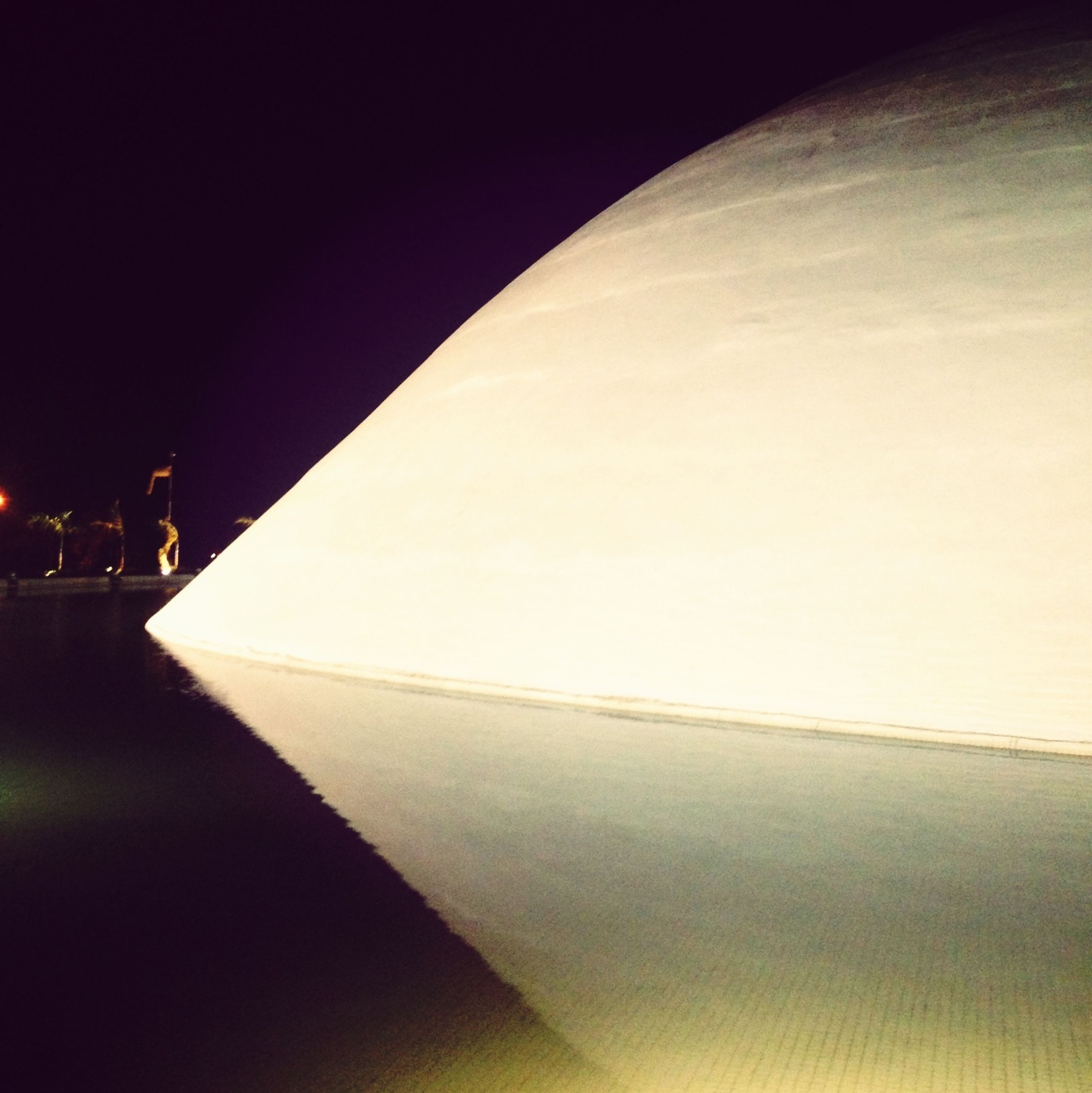 illuminated, built structure, architecture, night, indoors, copy space, the way forward, clear sky, shadow, sunlight, travel, travel destinations, diminishing perspective, famous place, lighting equipment, no people, tourism, wall - building feature, vanishing point