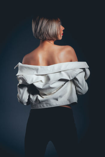 Adult Beautiful Woman Beauty Black Background Body Part Clothing Gray Gray Background Hair Hairstyle Indoors  Lifestyles Off Shoulder One Person Rear View Standing Studio Shot Three Quarter Length Women Young Adult Young Women The Portraitist - 2018 EyeEm Awards